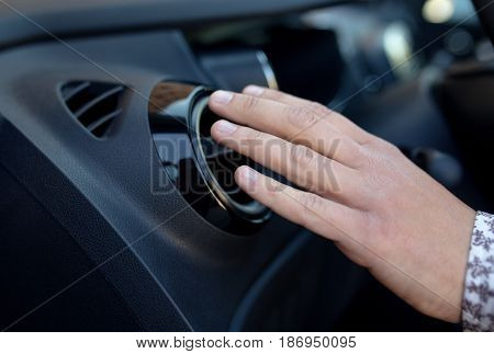 Driver hand on air ventilation grille with power regulator checking the air from air ventilation in the car