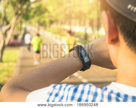 Woman checking Heart rate Exercise Outdoor Smart watch Sport equipment