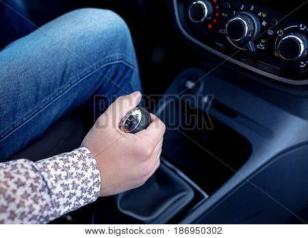 Man hand on the shift manual transmission close up