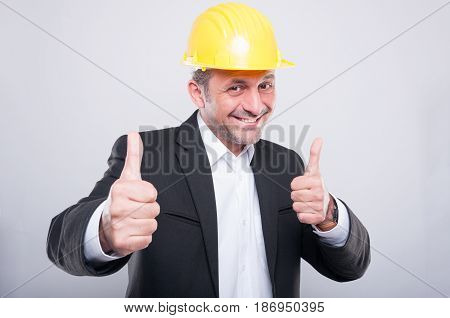 Foreman Wearing Hardhat Making Double Thumb Up Gesture