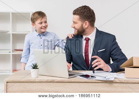 Naughty Boy With His Father Businessman At Office