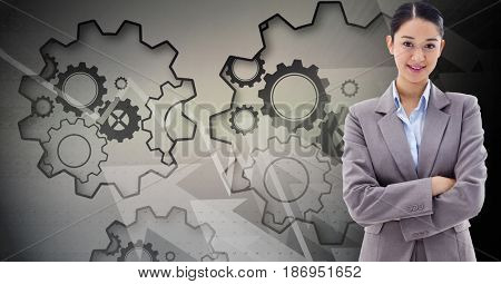 Digital composite of Digital composite image of businesswoman with gears in background