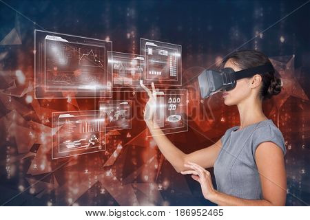 Digital composite of Digital composite image of woman touching futuristic screen while using VR glasses