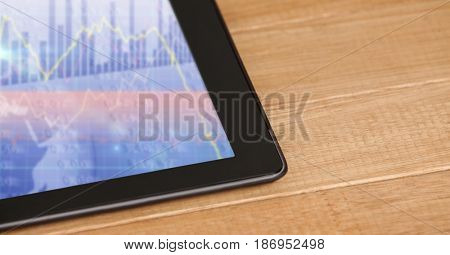 Digital composite of Cropped image of tablet computer on table