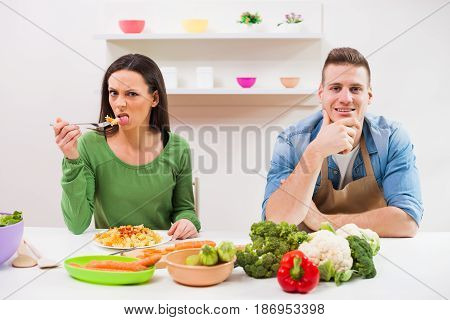 Woman is not satisfied with meal made by her husband.