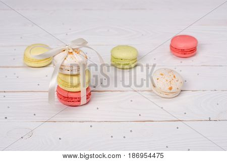 Colorful Macarons Tying With White Ribbon For Gift. Still Life Of Fresh Macarons Concept.