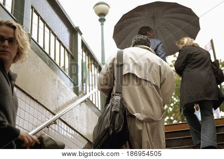 People ascending stairs out of subway