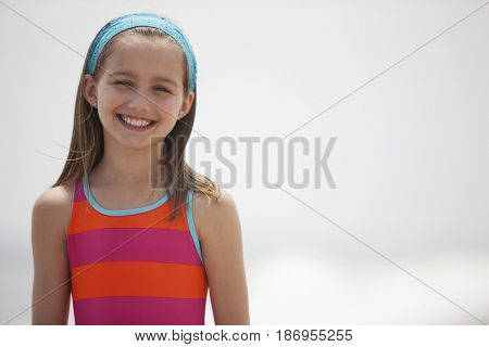 Smiling Caucasian girl in bathing suit