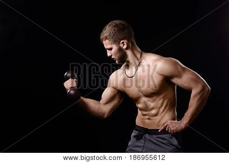 Young Bodybuilder With Dumbbells