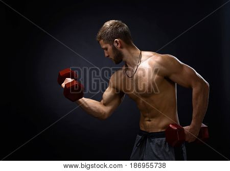 Young Bodybuilder On A Black Background