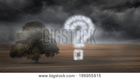 Digital composite of Question mark made of cloud texture by tree against storm clouds