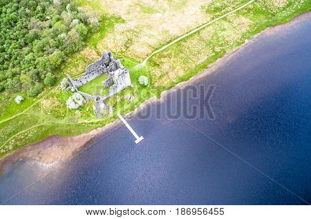 The ruins of historic Kilchurn Castle and jetty on Loch Awe, Argyll, Scotland