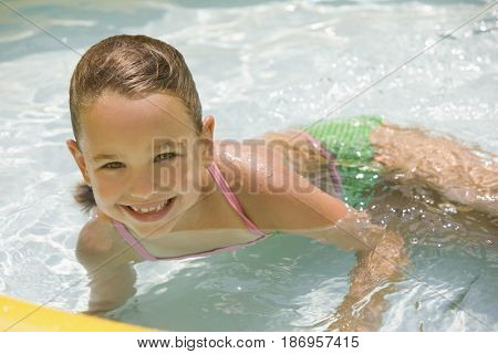 Girl playing in kiddie pool