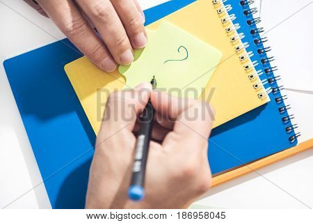 Close Up Of Human Hands Drawing Exclamation Mark On Note With Pen, Business Establishment