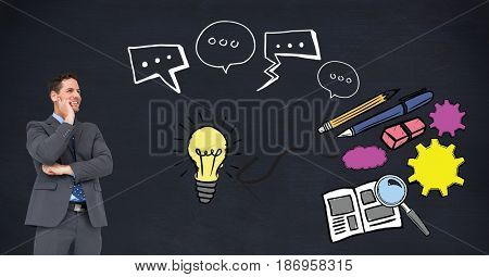 Digital composite of Digital composite image of businessman looking at idea graphics
