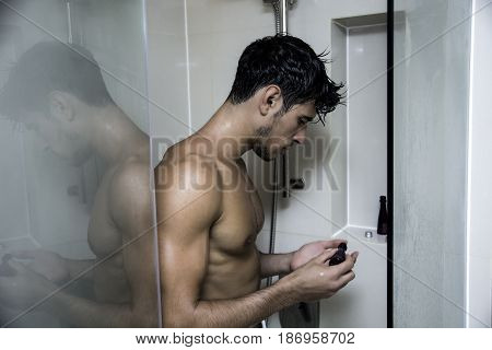 Close up Attractive Young Bare Muscular Man after Taking Shower, Getting Soap or Bathfoam or Shampoo