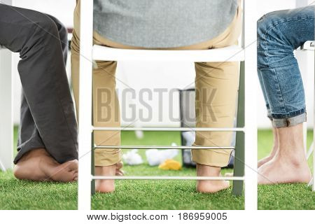 Partial View Of Barefoot Businessmen Sitting At Table And Working On New Project, Business Teamwork