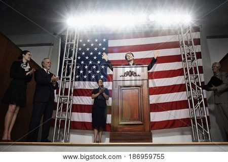Female politician making speech at podium