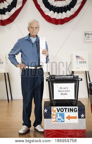 Caucasian voter voting in polling place