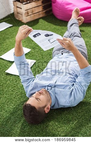 Side View Of Focused Businessman Analyzing Documents, Business Establishment  Concept