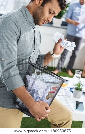 Side View Of Pensive Businessman Holding Trash Bucket, Business Teamwork