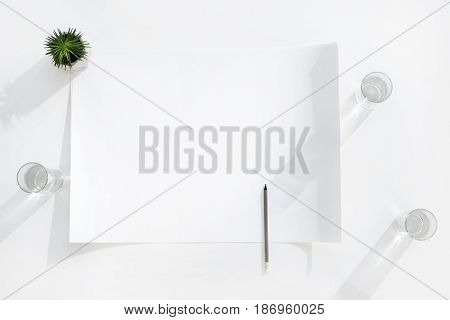 top view of empty white banner with pencil and glasses of water business establishment