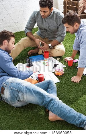 Side View Of Business People Working On New Business Plan, Business Teamwork