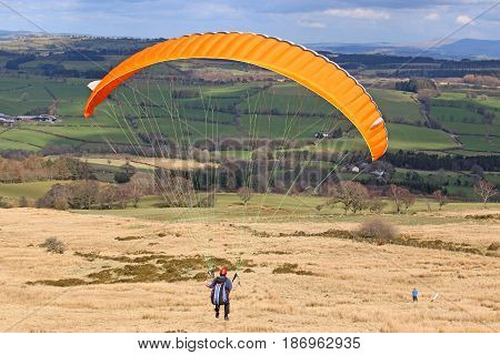 Paraglider about to launch in the Brecon Beacons