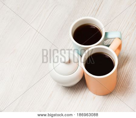 Two cups of coffee on white wooden table. Top view flat lay