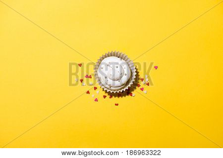 Birthday cupcake against in a yellow background