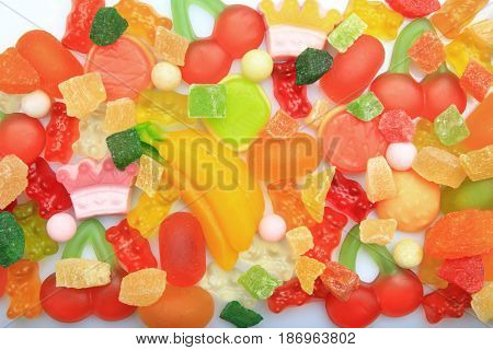 Tasty and colorful jelly candies on white background, closeup