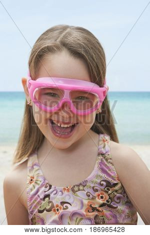 Caucasian girl in bathing suit and goggles