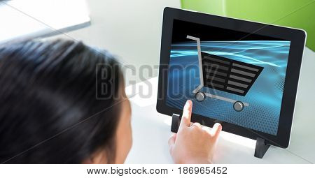Digital composite of Cropped image of person touching shopping cart icon on tablet PC