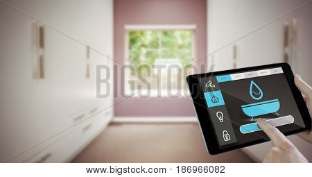 Digital composite of Hand using smart home app on tablet computer