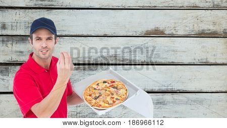 Digital composite of Delivery man gesturing while holding fresh pizza
