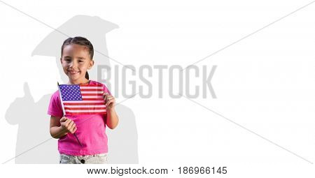 Digital composite of Digital composite image of girl holding American flag with graduate shadow in back