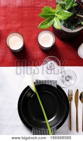 Beautiful table setting with flower and candles
