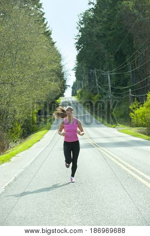 Mixed race runner training on remote road