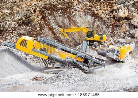 Digger and excavator in the quarry closeup picture