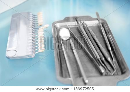 Table with dental instruments in modern clinic, closeup