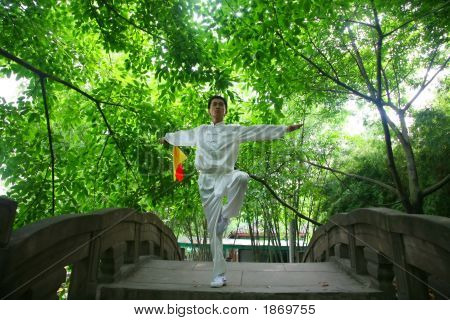 Asian young man display the chinese KongFu poster