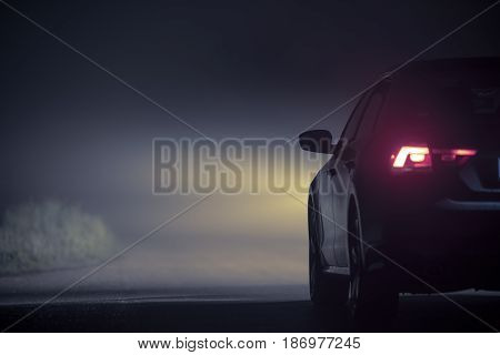 Driving in Dense Fog at Night. Modern Car on the Foggy Road During Night Hours. Foggy Highway Conditions.