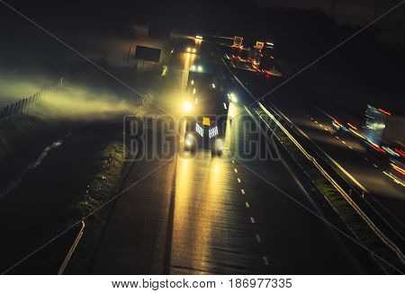 Foggy Highway Evening Commute Traffic. Motion Blur Long Exposure Concept.