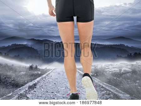 Digital composite of Walking or jogging on mountain path