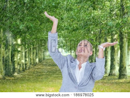 Digital composite of Business woman under the rain in the park