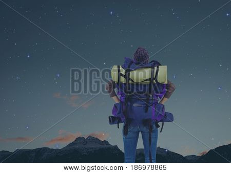 Digital composite of mountain travel, woman with bag at night