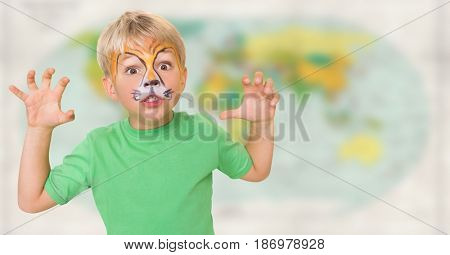 Digital composite of Boy with facepaint growling against blurry map