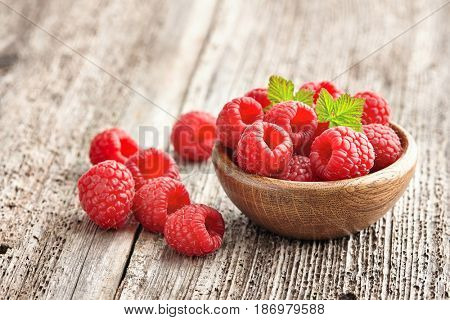 Raspberry on a wooden background