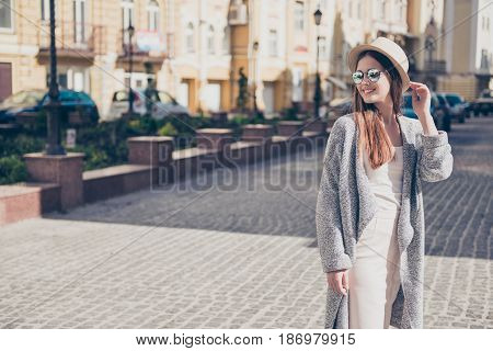 Happy Young Girl On Vacation In A Stylish Hat And Sunglasses, Wearing Pure Light Dress And Cardigan,