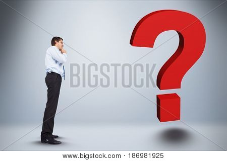 Digital composite of Digital composite image of businessman looking at question mark